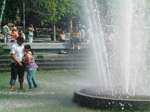 cooling off in the fountain, Washington Square Park NYC